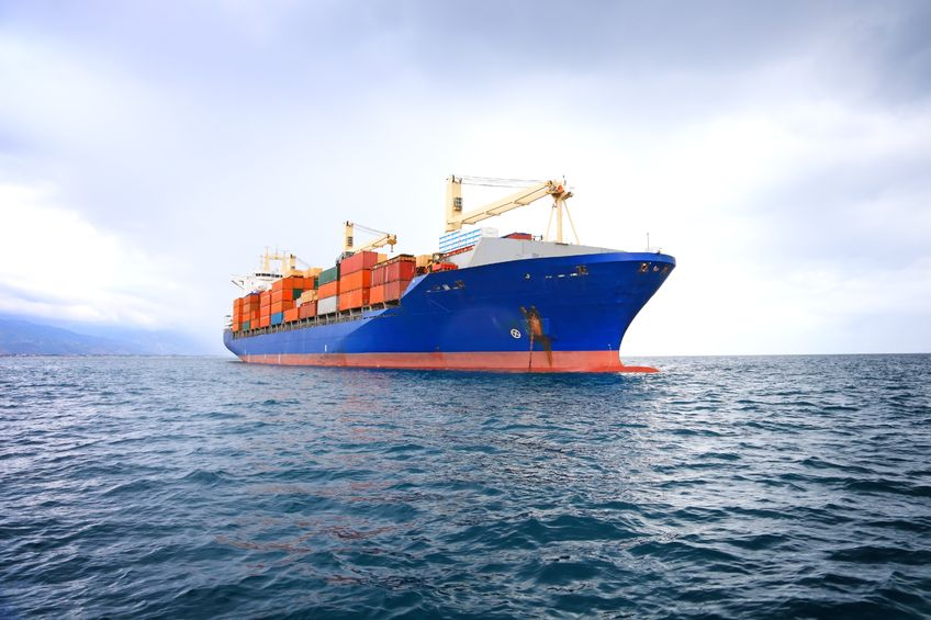 10536430 - commercial container ship with dramatic sky